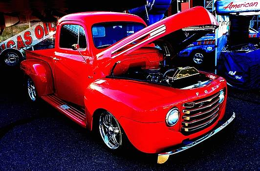 Shiny Red Ford Truck by Natalie Ortiz