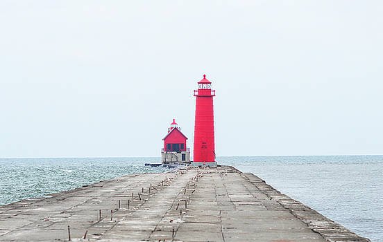 Snow at Grand Haven Light by Tammy Chesney