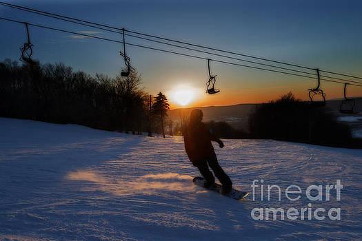 Dan Friend - Snow boarding top of mountain