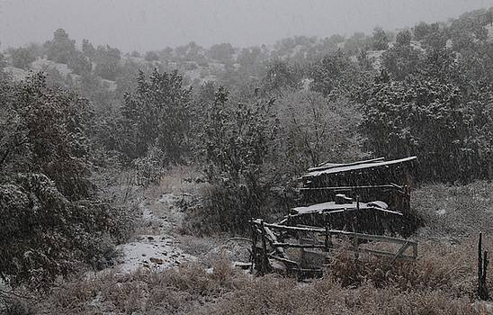 Snow in the Old Santa Fe Corral by Christopher Kirby
