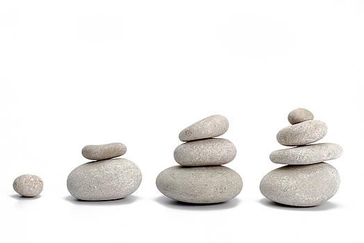 Sami Sarkis - Stacks of pebbles on white background