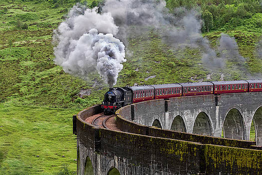 Steam train crossing the Glenfinnan Viaduct by Derek Beattie