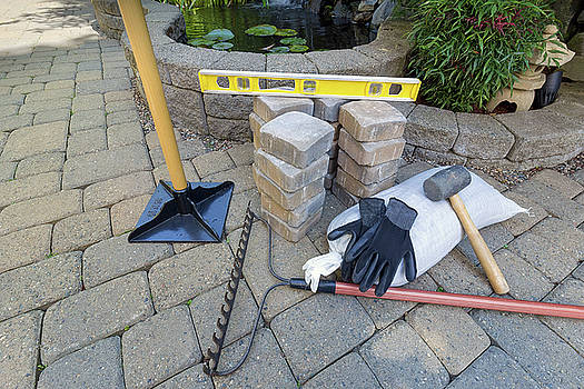 Stone Brick Pavers with Garden Tools by Jit Lim
