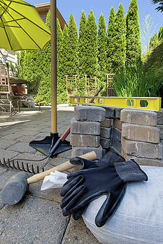 Stone Pavers and Tools for Backyard Hardscape by Jit Lim