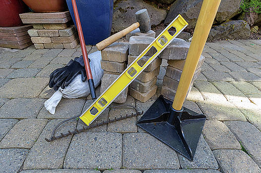 Stone Pavers and Tools for Landscaping by Jit Lim