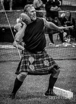 Stone Put - Scottish Festival and Highland Games by Gary Whitton