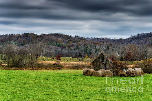 Storm Clouds and Hay Bales by Thomas R Fletcher