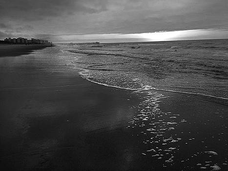 Storm over Sunrise at Myrtle Beach in Black and White by Kelly Hazel