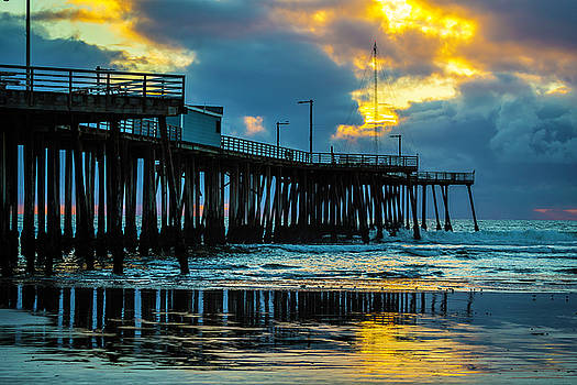 Stormy Pier Sunset by Garry Gay