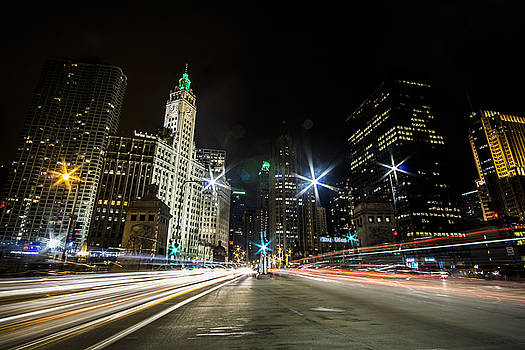 streaks of light zooming by you  on Chicago's Mag Mile by Sven Brogren