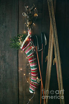 Sandra Cunningham - Striped wool stocking with old skis and sparkling lights
