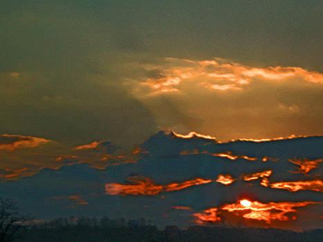 Sun Peering Through the Clouds by Skyler Tipton