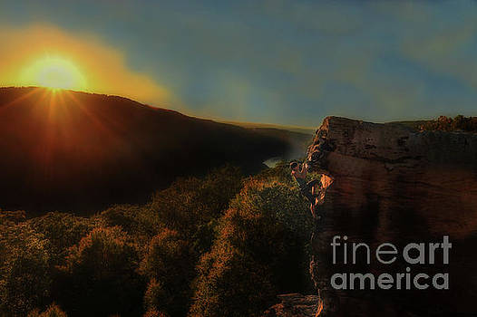 Sun setting on rock climber by Dan Friend