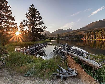 Sunburst over Sprague Lake by Lois Lake