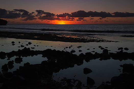 Sunrise At Shipwreck Beach by Roger Mullenhour