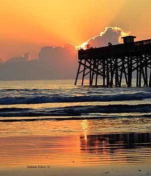Sunrise behind the pier 4-24-16 by Julianne Felton