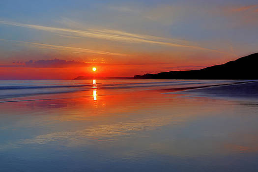 Sunrise on the coast by Roy McPeak