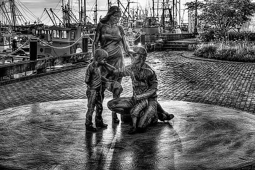 Sunrise over Fishermen's Tribute Memorial  by John Hoey