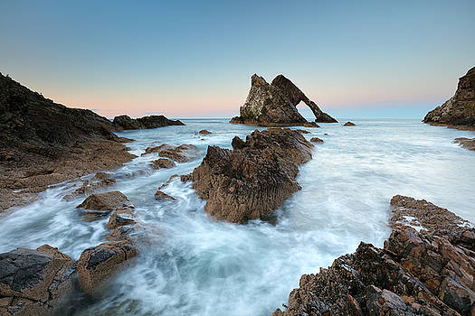 Sunset at Bow Fiddle Rock by Grant Glendinning