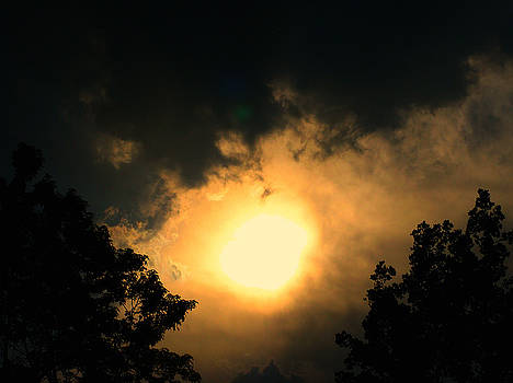 Sunset in a storm by Terry and Brittany Sprinkle