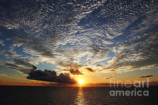 Sunset Through Clouds by Deanna Wright