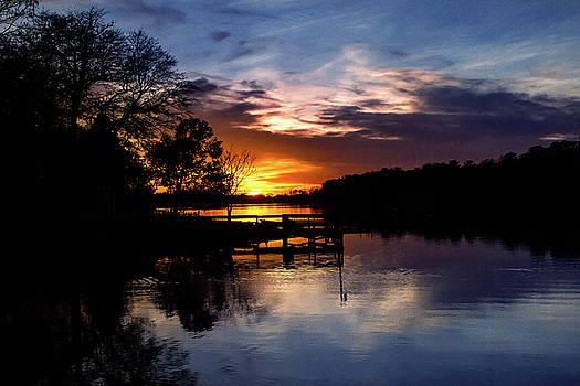 Sunset Through the Dock by Deborah Flowers