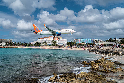 Sunwing Airlines arriving at St. Maarten airport. by David Gleeson
