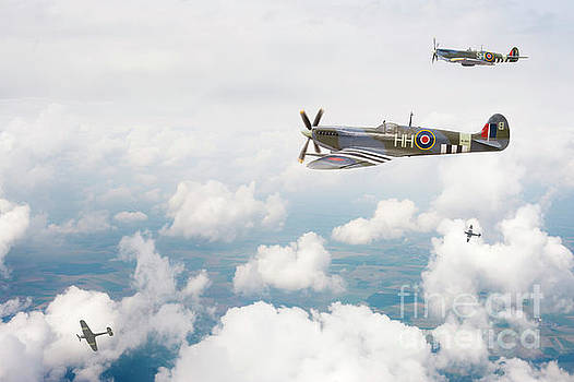 Supermarine Spitfire Airplanes Flying In The Sky by Lee Avison