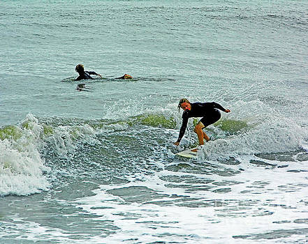 Surfers at Wabasso by D Hackett
