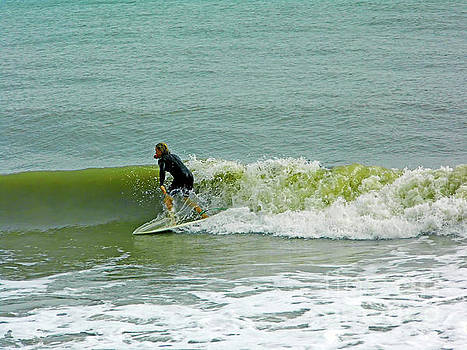 Surfing At Wabasso by D Hackett