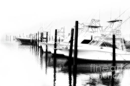 Dan Carmichael - Surreal Fishing Boats in Outer Banks Marina BW