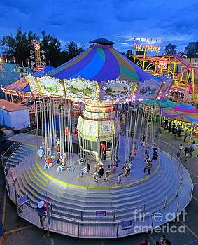 Swing Ride at the Fairgrounds by John Malone