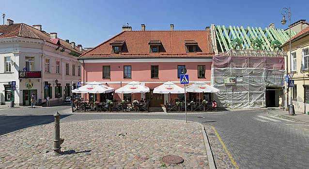 The central square and  Amstel beer street pub by Aleksandr Volkov