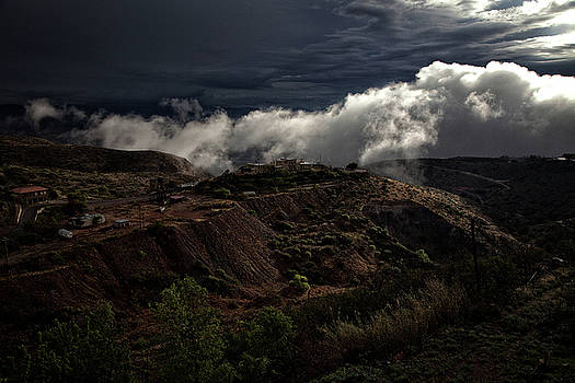The Jerome State Park with low lying clouds after storm by Ron Chilston