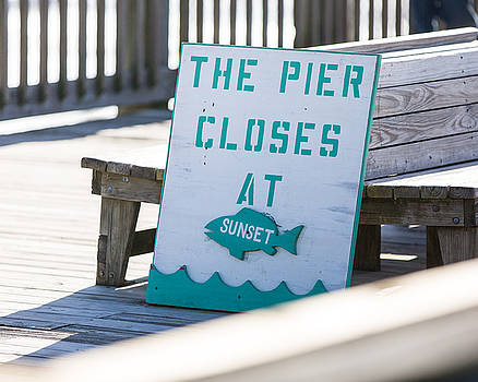 The Pier Closes at Sunset by Brent Paape