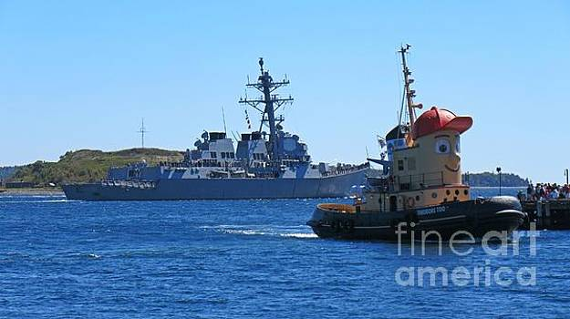 Theodore Tugboat with Naval Vessel Passing in Background by John Malone