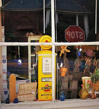 There is a Gas pump in the Window by Rodney Williams