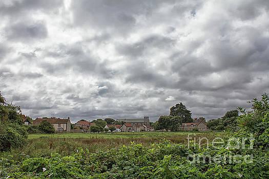 Thornham village under a leaden sky by John Edwards