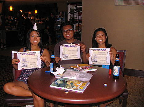Three Happy Graduates by Jim Williams