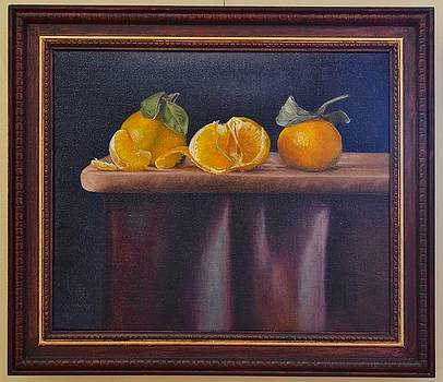 Three tangerines celebrating by Ralph Taeger