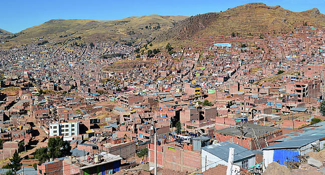 Top view on roofs and streets of Cusco town by Aleksandr Volkov