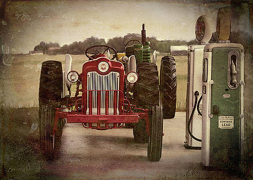 Tractor and gas pumps by Bonnie Willis