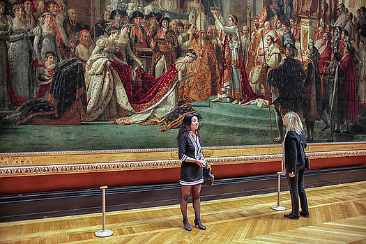 Two female tourists in front of The Coronation of Napoleon  by Patricia Hofmeester