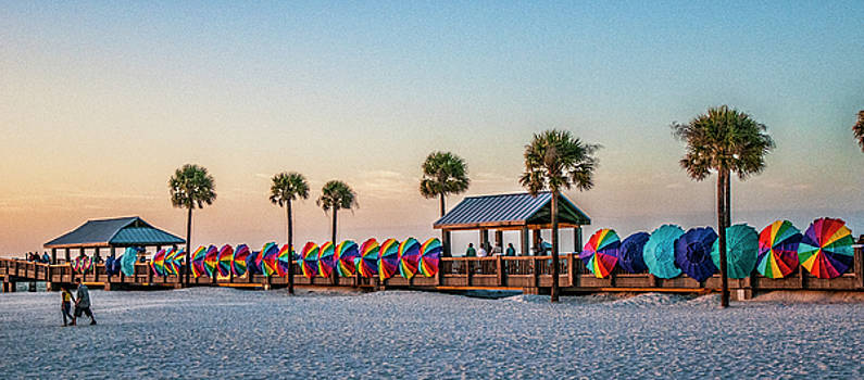 Umbrella windbreaks at Clearwater Florida. by Brian Tarr