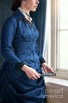 Victorian Woman In A Blue Dress At The Window by Lee Avison