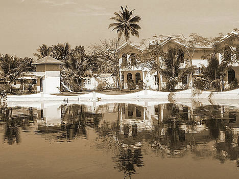 View of the cottages and lagoon water by Ashish Agarwal