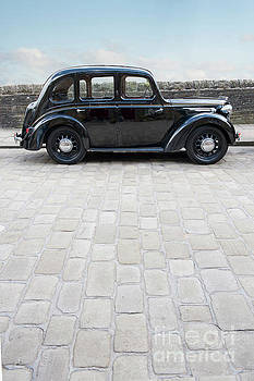 Vintage 1940s Car Parked On A Cobbled Street by Lee Avison