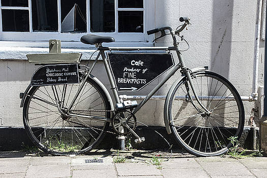 Vintage Bicycle with advertising sign for breakfast and cafe. by Tom Conway