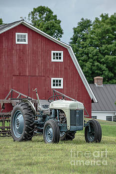 Vintage Ford farm tractor with red barn by Edward Fielding