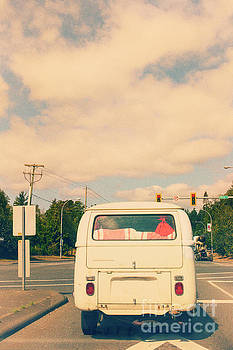 Vintage VW bus on the road by Patricia Hofmeester